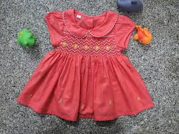 Bộ quần áo trẻ em thêu tay
