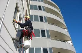 Dịch vụ lau kính toà nhà